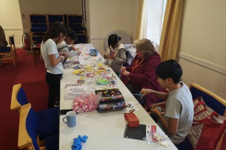 busy making light party bags for the free lunch ministry.jpg